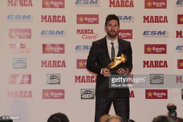 Barcelona's Argentinian striker Lionel Messi poses with his last Golden Boot Gala trophy as top scorer in all European soccer leagues of the 201617...