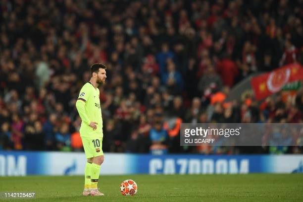 TOPSHOT Barcelona's Argentinian striker Lionel Messi reacts after Liverpool scored their fourth goal during the UEFA Champions league semifinal...