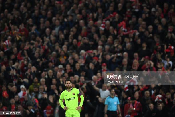 Barcelona's Argentinian striker Lionel Messi reacts after losing the UEFA Champions league semifinal second leg football match between Liverpool and...