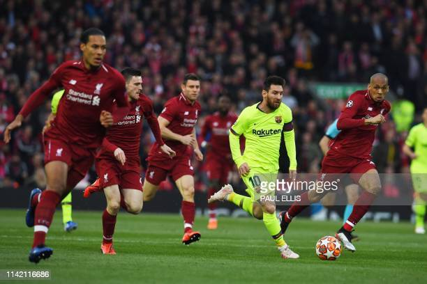 TOPSHOT Barcelona's Argentinian striker Lionel Messi runs during the UEFA Champions league semifinal second leg football match between Liverpool and...