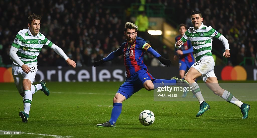 TOPSHOT - Barcelona's Argentinian striker Lionel Messi (C) shoots to score the opening goal during the UEFA Champions League group C football match between Celtic and Barcelona at Celtic Park in Glasgow on November 23, 2016. / AFP / Paul ELLIS