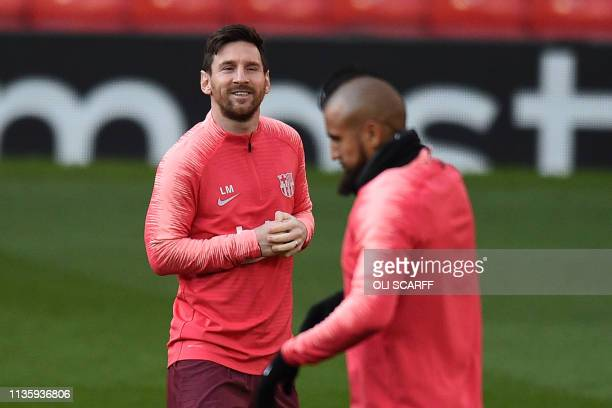 Barcelona's Argentinian striker Lionel Messi smiles during a training session at Old Trafford stadium in Manchester north west England on April 9 on...