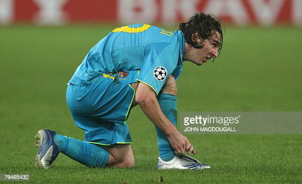 Barcelona's Argentinian striker Lionel Messi ties his shoe lace after it fell off in a foul during the Stuttgart vs Barcelona group E Champions...