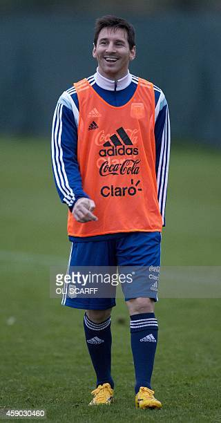 Barcelona's Argentinian striker Lionel Messi trains with the Argentina national football squad at Manchester City Football Club's Carrington Training...