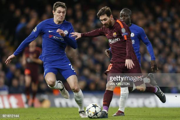 Barcelona's Argentinian striker Lionel Messi vies with Chelsea's Danish defender Andreas Christensen and Chelsea's French midfielder N'Golo Kante...