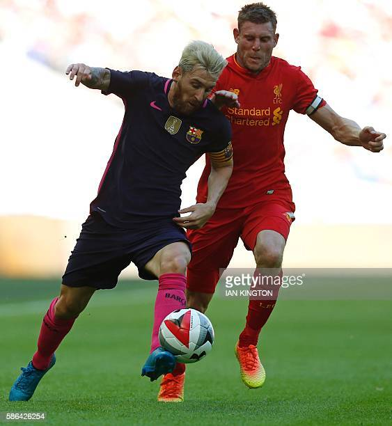 Barcelona's Argentinian striker Lionel Messi vies with Liverpool's English midfielder James Milner during the preseason International Champions Cup...
