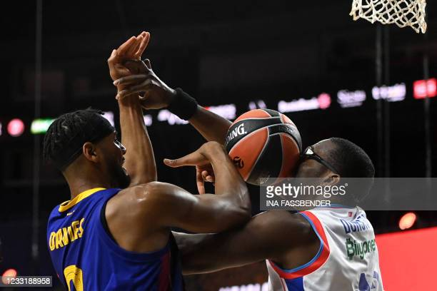 Barcelona's Brandon Davies and Anadolu Efes Istanbul's Bryant Dunston vie for the ball during the Basketball Euroleague Final Four championship final...