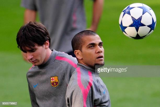 Barcelona's Brazilian defender Dani Alves and Barcelona's Argentinian forward Leonel Messi take part in a training session at Santiago Bernabeu...