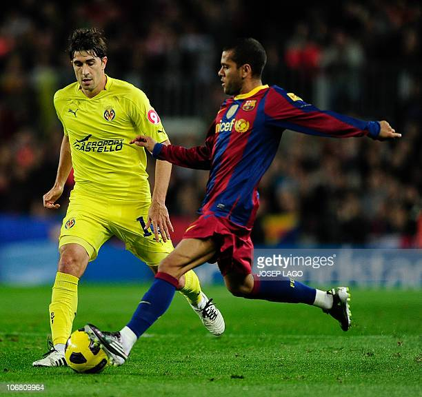 Barcelona's Brazilian defender Daniel Alves vies for the ball with Villarreal's midfielder Cani , during a Spanish League football match against...