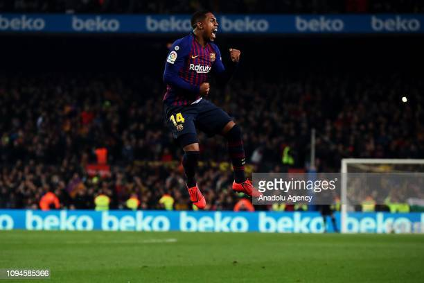 Barcelona's Brazilian forward Malcom Filipe celebrates after scoring a goal during Spanish Copa del Rey football match between FC Barcelona and Real...