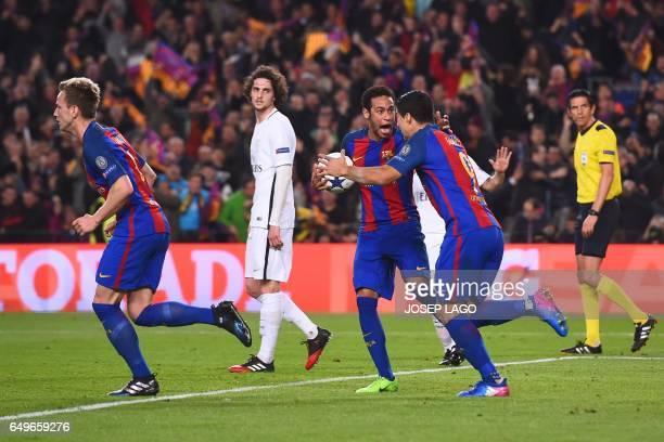 Barcelona's Brazilian forward Neymar and Barcelona's Uruguayan forward Luis Suarez celebrates their second goal during the UEFA Champions League...
