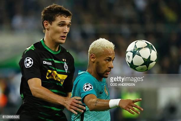 Barcelona's Brazilian forward Neymar and Moenchengladbach's Danish defender Andreas Christensen vie for the ball during the UEFA Champions League...