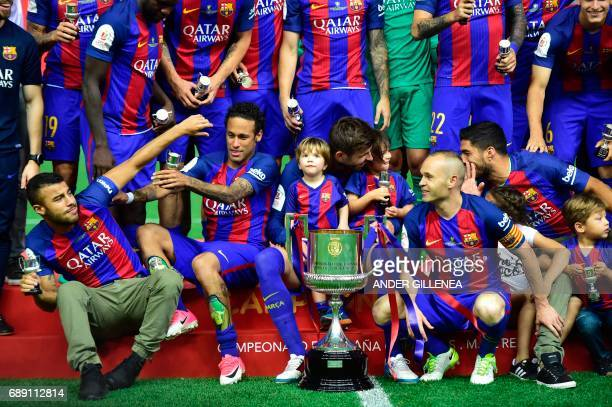 Barcelona's Brazilian forward Neymar Barcelona's Argentinian forward Lionel Messi Barcelona's midfielder Andres Iniesta and teammates pose with the...