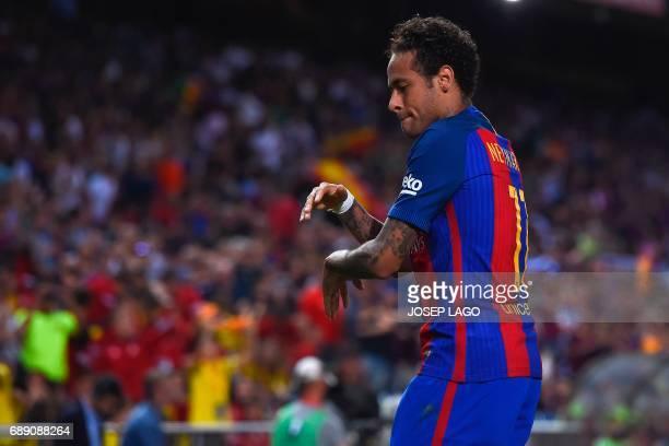 Barcelona's Brazilian forward Neymar celebrates after scoring during the Spanish Copa del Rey final football match FC Barcelona vs Deportivo Alaves...