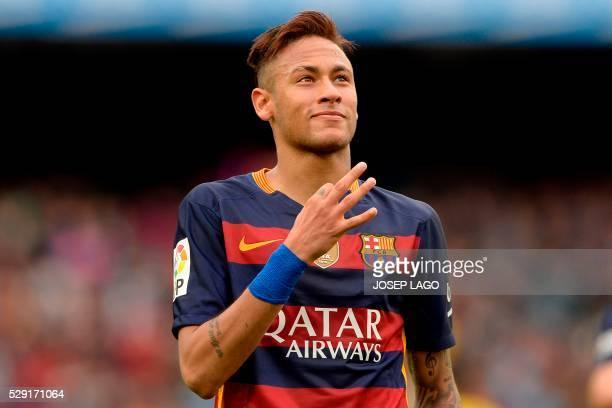 Barcelona's Brazilian forward Neymar celebrates his goal during the Spanish league football match FC Barcelona vs RCD Espanyol at the Camp Nou...