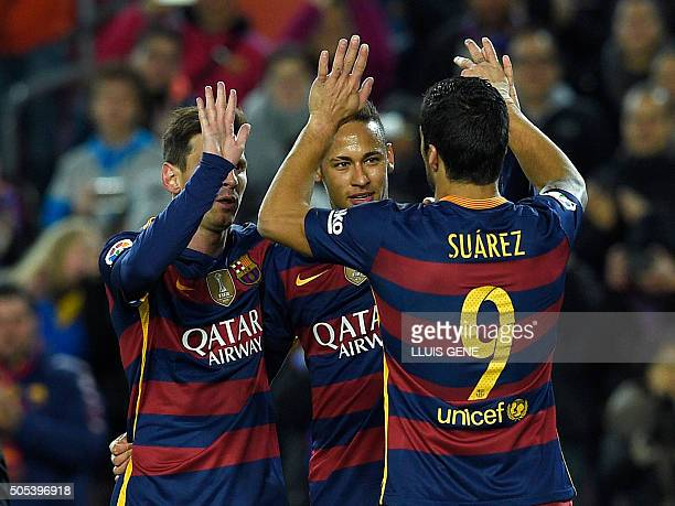 TOPSHOT Barcelona's Brazilian forward Neymar celebrates with Barcelona's Argentinian forward Lionel Messi and Barcelona's Uruguayan forward Luis...