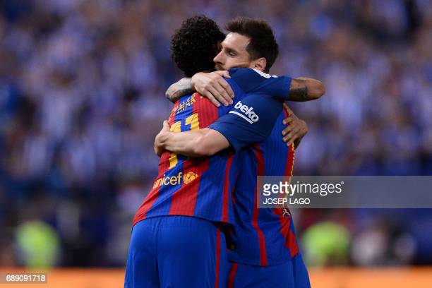 Barcelona's Brazilian forward Neymar celebrates with Barcelona's Argentinian forward Lionel Messi after scoring during the Spanish Copa del Rey final...