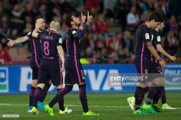 Barcelona's Brazilian forward Neymar da Silva celebrates after scoring during the Spanish league football match Granada FC vs FC Barcelona at Nuevo...