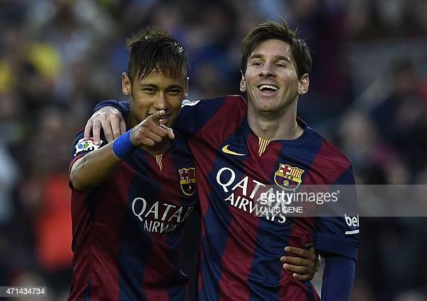 Barcelona's Brazilian forward Neymar da Silva Santos Junior and Barcelona's Argentinian forward Lionel Messi celebrate after scoring a goal during...