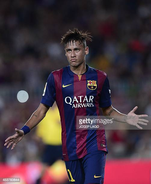 Barcelona's Brazilian forward Neymar da Silva Santos Junior celebrates his goal during the 49th Joan Gamper Trophy football match FC Barcelona vs...