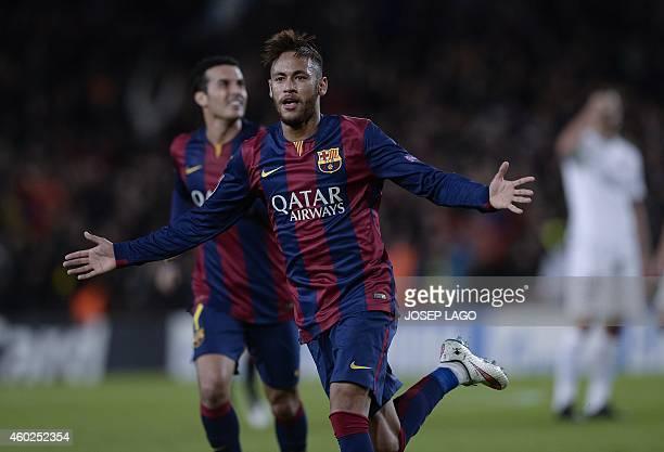Barcelona's Brazilian forward Neymar da Silva Santos Junior celebrates after scoring during the UEFA Champions League Group F football match FC...