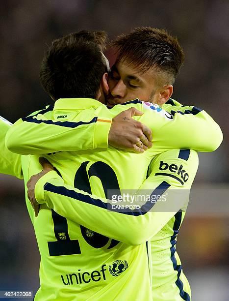 Barcelona's Brazilian forward Neymar da Silva Santos Junior celebrates with a teammate after scoring during the Spanish Copa del Rey quarter final...