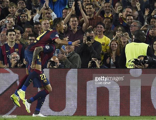 Barcelona's Brazilian forward Neymar da Silva Santos Junior celebrates with Barcelona's Brazilian defender Dani Alves after scoring a goal during the...