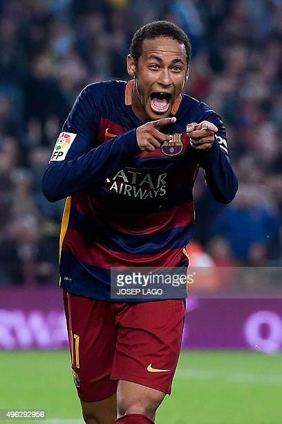 Barcelona's Brazilian forward Neymar da Silva Santos Junior celebrates his goal during the Spanish league football match FC Barcelona vs Villarreal...