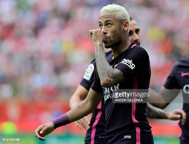Barcelona's Brazilian forward Neymar da Silva Santos Junior celebrates after scoring his team's third goal during the Spanish league football match...