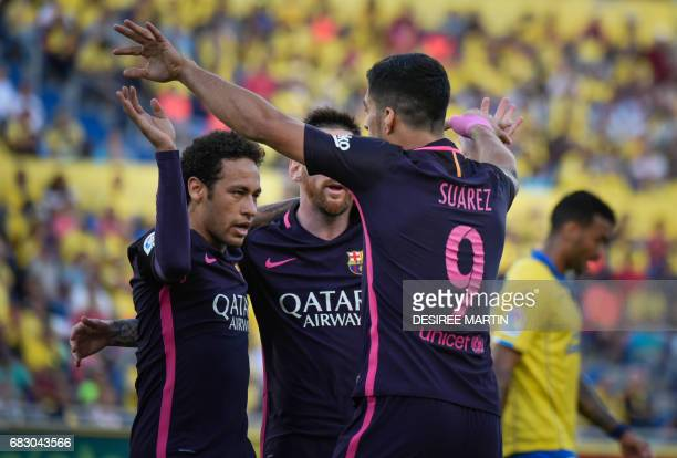 Barcelona's Brazilian forward Neymar da Silva Santos Junior celebrates his goal with Barcelona's Uruguayan forward Luis Suarez and Barcelona's...