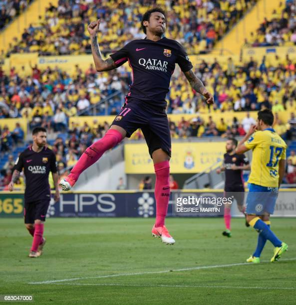 Barcelona's Brazilian forward Neymar da Silva Santos Junior celebrates his goal during the Spanish league football match UD Las Palmas vs FC...