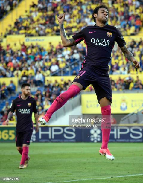 Barcelona's Brazilian forward Neymar da Silva Santos Junior celebrates his second goal during the Spanish league football match UD Las Palmas vs FC...