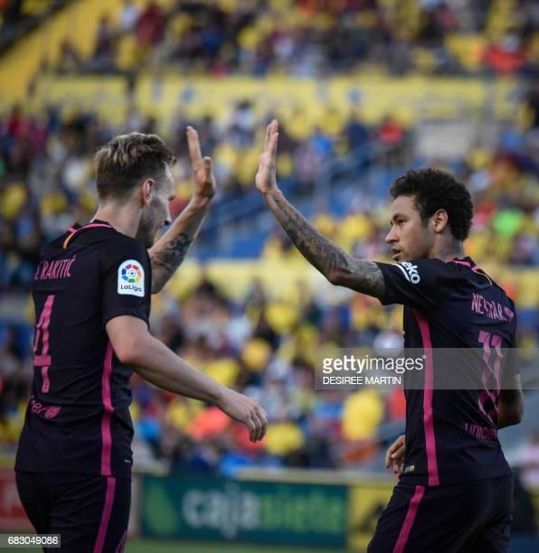 Barcelona's Brazilian forward Neymar da Silva Santos Junior celebrates his second goal with teammate Barcelona's Croatian midfielder Ivan Rakitic...