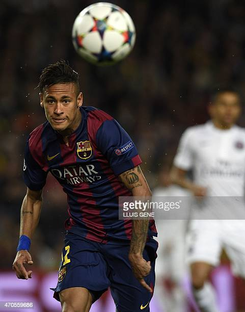 Barcelona's Brazilian forward Neymar da Silva Santos Junior eyes the ball during the UEFA Champions League quarter-finals second leg football match...