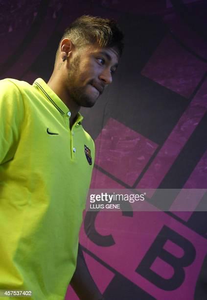 Barcelona's Brazilian forward Neymar da Silva Santos Junior gestures after a press conference at the Sports Center FC Barcelona Joan Gamper in Sant...