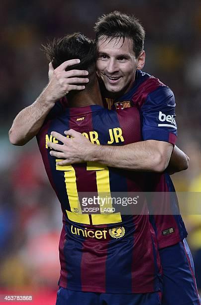 Barcelona's Brazilian forward Neymar da Silva Santos Junior is congratulated by his teammate Barcelona's Argentinian forward Lionel Messi during the...