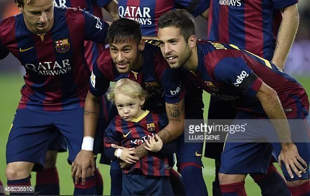 Barcelona's Brazilian forward Neymar da Silva Santos Junior poses with his son before the Spanish league football match FC Barcelona vs RC Celta de...