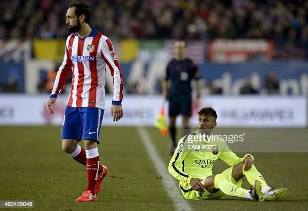 Barcelona's Brazilian forward Neymar da Silva Santos Junior reacts past Atletico Madrid's defender Juanfran during the Spanish Copa del Rey quarter...