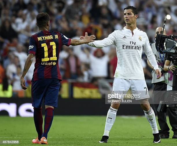 Barcelona's Brazilian forward Neymar da Silva Santos Junior congratulates Real Madrid's Portuguese forward Cristiano Ronaldo on winning after the...