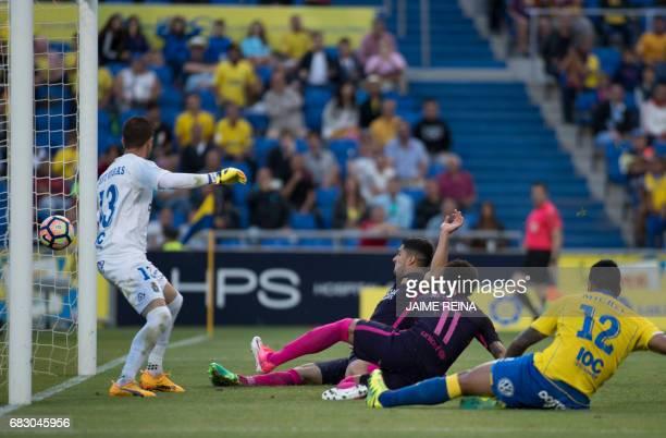 Barcelona's Brazilian forward Neymar da Silva Santos Junior scores a goal during the Spanish league football match UD Las Palmas vs FC Barcelona at...