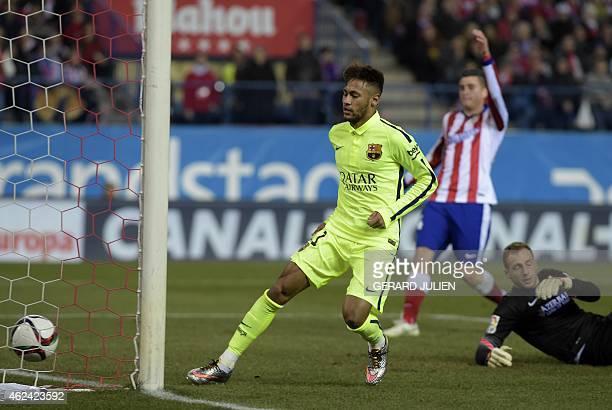 Barcelona's Brazilian forward Neymar da Silva Santos Junior scores his second goal during the Spanish Copa del Rey quarter final second leg football...