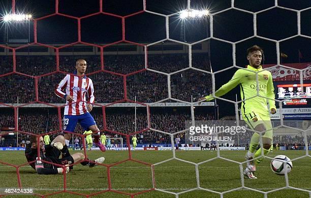 Barcelona's Brazilian forward Neymar da Silva Santos Junior scores during the Spanish Copa del Rey quarter final second leg football match Club...