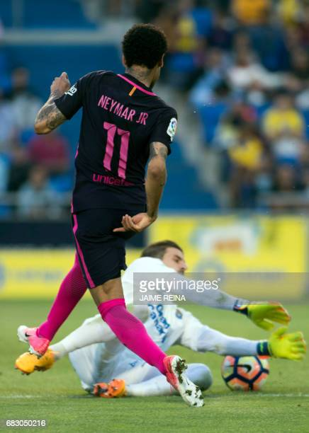 Barcelona's Brazilian forward Neymar da Silva Santos Junior shots to score a goal during the Spanish league football match UD Las Palmas vs FC...