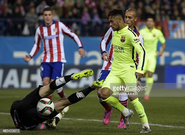 Barcelona's Brazilian forward Neymar da Silva Santos Junior vies with Atletico Madrid's Slovenian goalkeeper Jan Oblak during the Spanish Copa del...