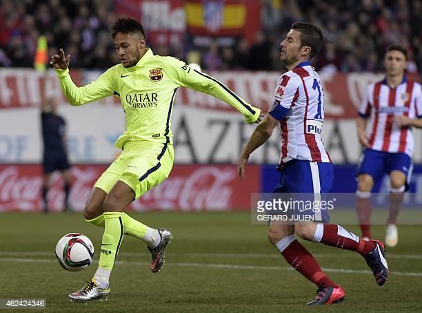 Barcelona's Brazilian forward Neymar da Silva Santos Junior vies with Atletico Madrid's midfielder Gabi during the Spanish Copa del Rey quarter final...