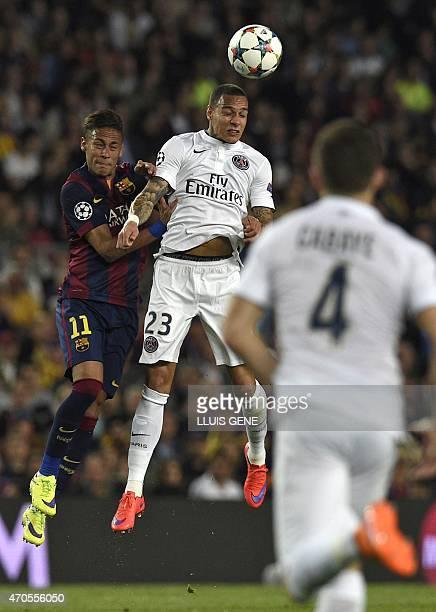 Barcelona's Brazilian forward Neymar da Silva Santos Junior vies with Paris Saint-Germain's Dutch defender Gregory Van der Wiel during the UEFA...