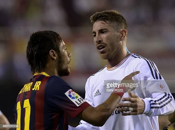 Barcelona's Brazilian forward Neymar da Silva Santos Junior vies with Real Madrid's defender Sergio Ramos during the Spanish Copa del Rey final...