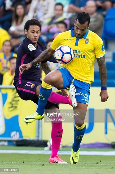 Barcelona's Brazilian forward Neymar da Silva Santos Junior vies with las Palmas' Brazilian defender Michel Macero Rocha during the Spanish league...