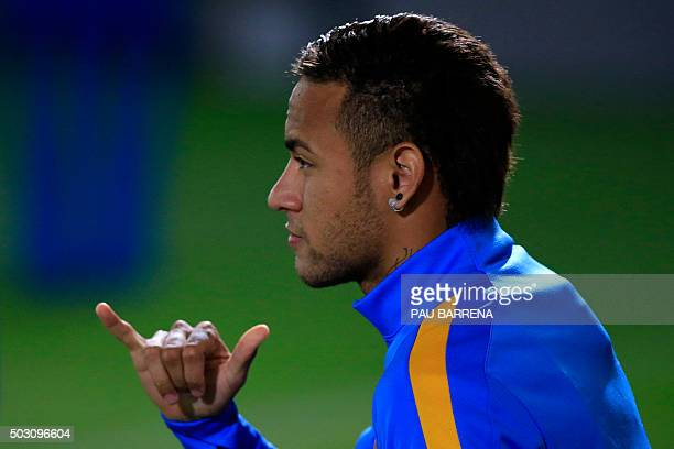Barcelona's Brazilian forward Neymar gestures as he arrives at the first training session of the year at the Sports Center FC Barcelona Joan Gamper...