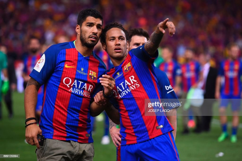 Barcelona's Brazilian forward Neymar (R) gestures past Barcelona's Uruguayan forward Luis Suarez at the end of the Spanish Copa del Rey (King's Cup) final football match FC Barcelona vs Deportivo Alaves at the Vicente Calderon stadium in Madrid on May 27, 2017. Barcelona won 3-1. / AFP PHOTO / Josep LAGO